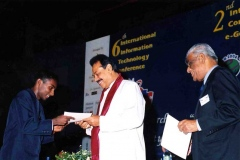 Hon Mahinda Rajapaksa Prime Minister as Chief Guest at the Joint IITC2004 and ICEG2004 awarding certificates of recognition to the IOI team that did extremely well by winning 1 Gold and 3 Bronze medals.