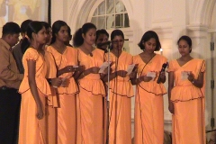 Members of the musical group of the University of Colombo Arts Council sing the Felicitation song composed by Kamal Waleboda at the Felicitation to Prof. Samaranayake held in December 2004. Prof Samaranayake is a former Chairman of the Arts Counci