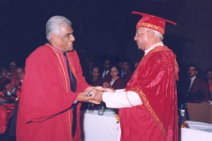 Prof. Samaranayake receiving the degree of D.Sc. ( Honoris Causa ) from Most Rev Bishop Oswald Gomis, Chacellor of the University of Colombo at the 2004 convocation held in January 2005