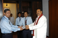 Mr S S P Mahanama handed over a free copy of Mahanamas Sinhala Word Processor to Mr Mahinda Rajapaksa at the Parliament Premise on the 06th July 2005