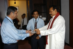 Mr S S P Mahanama handed over a free copy of Mahanamas Sinhala Word Processor to then the Prime Minister Mr Mahinda Rajapaksa at the Parliament premises on the 06thJuly 2005.