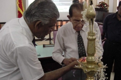 Chancellor Dr. P. R. Anthonis lighting the Traditional Oil Lamp to mark the establishment of the University of Colombo School of Computing UCSC on 1st September 2002.