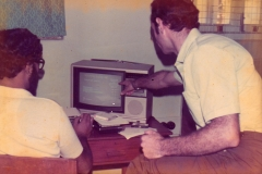Dr Roger Stern of the University of Reading (r) and Buddy Liyanage of the University of Colombo developing the election software on the BBC Micro computer. Note the computer display is a TV.